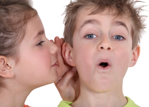 little-girl-telling-brother