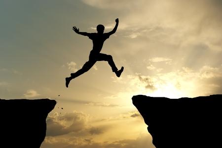 Man jumping through the gap.